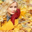 Autumn Girl. Fashion Blonde Beautiful Woman with Maple leaves in — Stock Photo