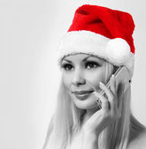 Santa Girl with Cell Phone. Blonde Happy Young Woman with Christ — Stock Photo