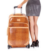 Travel Suitcase and Woman's Sexy Legs islated on white backgroun — Stock Photo