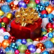Christmas Gift with Gold Bow and Colorful Balls. Christmas Decor — Stock Photo