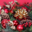 Christmas Decoration. Christmas tree branch with red bolls and g — Stock Photo #36233485