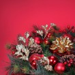 Christmas Decoration. Christmas tree branch with red bolls and g — Foto Stock