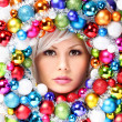 Christmas Woman with Colored Balls. Face of Beautiful Girl  — Foto de Stock