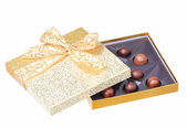Gold Candy Box with Truffles isolated on white. Christmas Gift — Foto de Stock