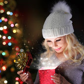 Christmas Miracle. Smiling Blonde Girl with Knitted Hat Opening — Fotografia Stock