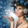 Stock Photo: Christmas Womwith Decorated Hairstyle Blowing Kiss. Snow Quee