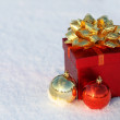Christmas Gift Box with Shiny Balls on Snow. Outside. Winter Sun — Stock Photo