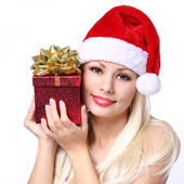 Christmas Woman with Gift Box. Happy Blonde Girl in Santa Hat — Stock Photo