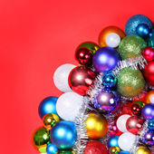 Christmas Balls. Colorful Christmas Decorations over red — Foto de Stock