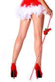 Sexy nohy. santa girl s obrovské candy cane stick izolované — Stock fotografie