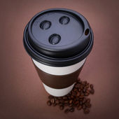 Paper Coffee cup with Coffee Beans on brown background. Takeaway — Stock Photo