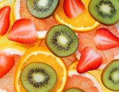 Sliced Fruits Background. Strawberry, Kiwi, Pineapple, Grapefruit, Orange — Stock Photo
