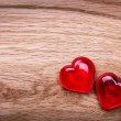 Stock Photo: Valentines Day background. Hearts on Wooden Texture