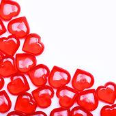 Rode harten geïsoleerd op een witte achtergrond met ruimte voor de tekst. — Stockfoto