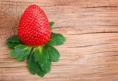 Delicious Strawberry on wooden background — Stock Photo