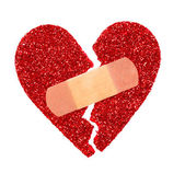 Broken Heart. Glitter ripped heart fixed with adhesive bandage — Stock Photo