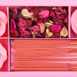 Spa Set. Roses Shaped Candles, peony dried leaves and incense sticks — Stock Photo #38629733