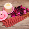 Stock Photo: Spa Set. Burning candles with roses dried leaves and incense sti