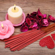Spa. Burning candles with dried roses leaves, incense sticks — Stock Photo #38629739