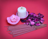Spa Set. Burning candles with roses dried leaves — Stock Photo