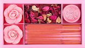 Spa Set. Roses Shaped Candles, peony dried leaves and incense sticks — Stock Photo