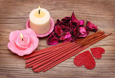 Spa. Burning candles with dried roses leaves, incense sticks — Stock Photo