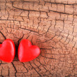 Hearts on Wooden Texture. Valentines Day background. Macro. — Stock Photo #38682851