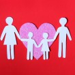 Paper Family in Pink Heart over on red background. Love, Kids — Stock Photo #38885505