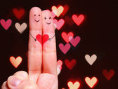 Happy Couple Concept. Two fingers in love with painted smiley fa — Stock Photo