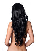 Curly Black Hair. Back side of young brunette woman isolated — Stock Photo
