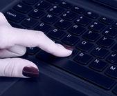 Female hand using computer keyboard — Stock Photo