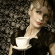 Retro Woman with Coffee Cup. Portrait of Fashion Beautiful Blond — Stock Photo #39420567