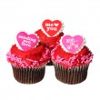 Chocolate cupcakes with red hearts on the tops, isolated — Stock Photo #40129859