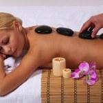 Spa Stone Massage. Beautiful Blonde Getting Hot Stones Massage — Stock Photo #40496543