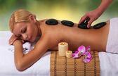 Spa Stone Massage. Beautiful Blonde Getting Hot Stones Massage — Stock Photo