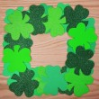 St. Patrick's Day. Shamrock Frame over wood background — Stock Photo