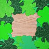 St. Patrick's Day. Shamrock Frame over wood background — Stock Photo