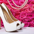 Bridal Shoes and Roses. White Heels over Hot Pink Flowers — Stock Photo #40981471