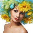 Stock Photo: Spring Woman. Beautiful Girl with Easter Eggs and Yellow Daisy
