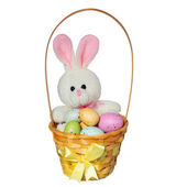 Easter basket with colorful eggs and bunny toy isolated on white — Stok fotoğraf