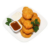 Chicken nuggets in plate with two dressings isolated on white — Stock Photo