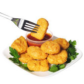 Chicken nuggets with ketchup isolated on white — Stock Photo
