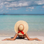 Vacation. Woman in Big Sun Hat tanning and relaxing on Beach — Stock Photo