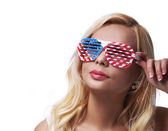 Blonde Girl with American Flags Sunglasses. Smiling Young Woman  — Stock Photo