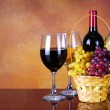 Wine Bottles and Glasses of Wine. Basket of Fresh Grapes — Stock Photo #44175493