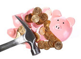 Broken Piggy Bank with Gold Coins and Hammer isolated on white.  — Stock Photo