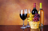 Wine Bottles and Glasses of Wine. Basket of Fresh Grapes — Photo