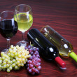 Bottles of Red and White Wine with Fresh Grapes. Glasses of Wine — Stock Photo #44410257