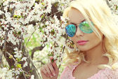 Blonde Girl with Aviator Sunglasses over Cherry Blossom. Spring  — Stock Photo