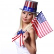 Blonde Girl waving Small American Flag isolated on white — Stock Photo